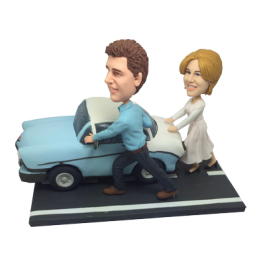 Couple Pushing Car
